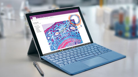 Surface Pro 4 with colorful OneNote page on screen, sitting on desk with Surface Pen