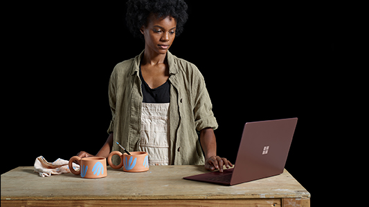 Kenesha working on Surface Laptop