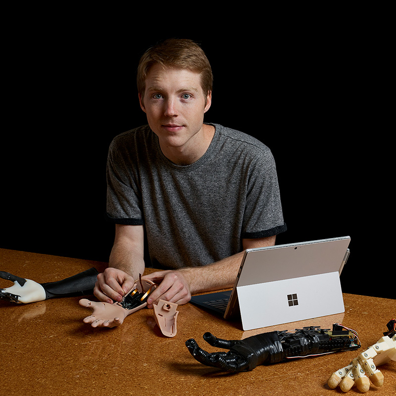 Easton LaChappelle with Surface Pro and his artificial limb designs.
