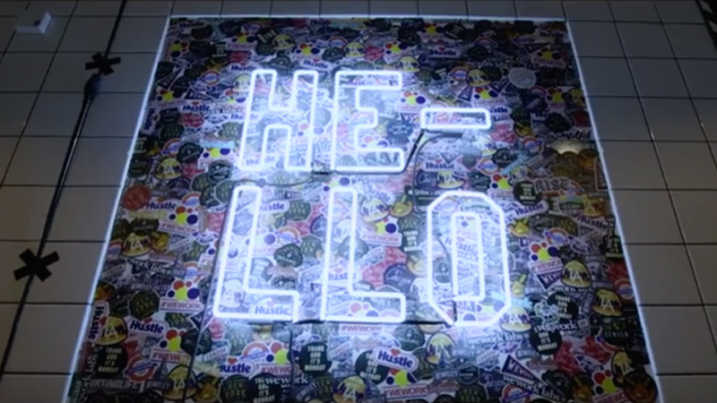Neon sign that spells Hello.