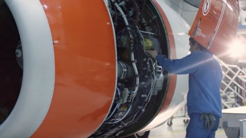 Man works on an airplane.