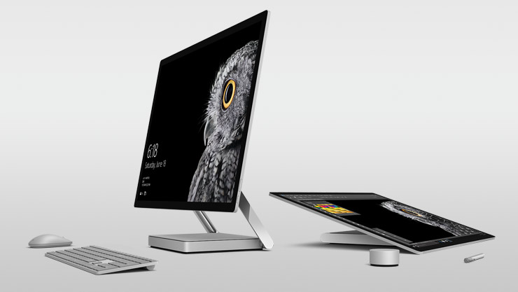 Desktop and studio view of Surface Studio with Surface Pen, Surface Dial, Surface Keyboard and Surface Mouse placed around them.