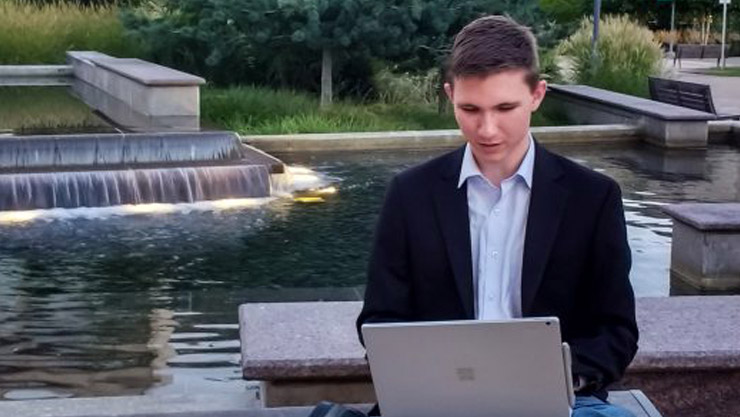Student types on Surface Book in an outdoor setting
