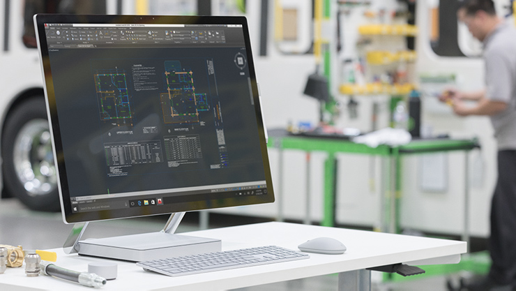 Bluebeam software shown on a Surface Studio in a repair shop.