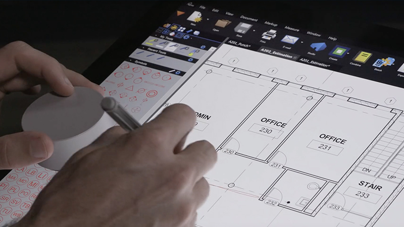 Person uses Surface Pen and Surface Dial in Bluebeam app on Surface Studio.