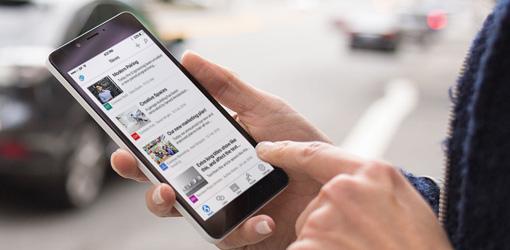 hands on a smart phone running SharePoint