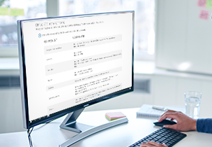 A PC screen on a desk, review the Office 365 system requirements