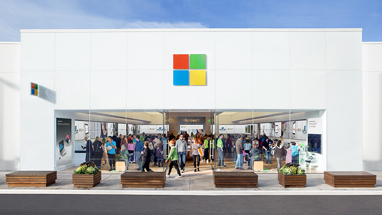 People gathering in and around a Microsoft Store