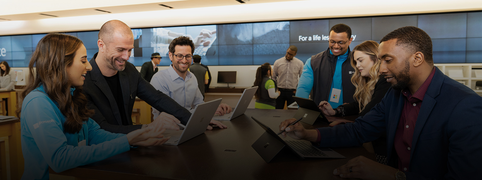 Microsoft Store business training event with various business professionals.