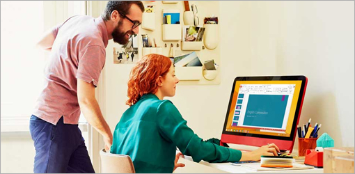 Man and woman looking at monitor, learn more about Office 2010 and how you can upgrade to Office 365