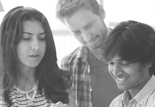 Three people looking at something together, Go to the Office 365 Partner Showcase