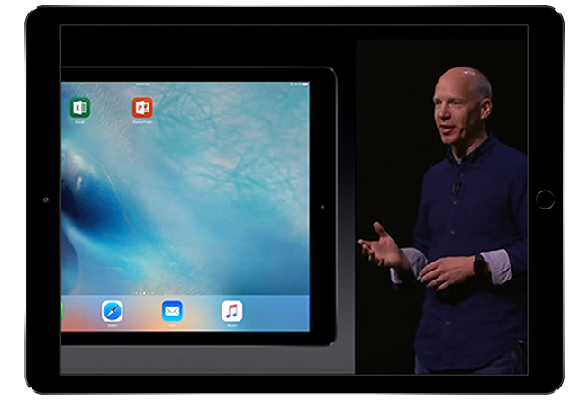 Screenshot from the video of Kirk Koenigsbauer on stage at Apple Keynote, play in-page video demo of Office 365 on the iPad Pro™.