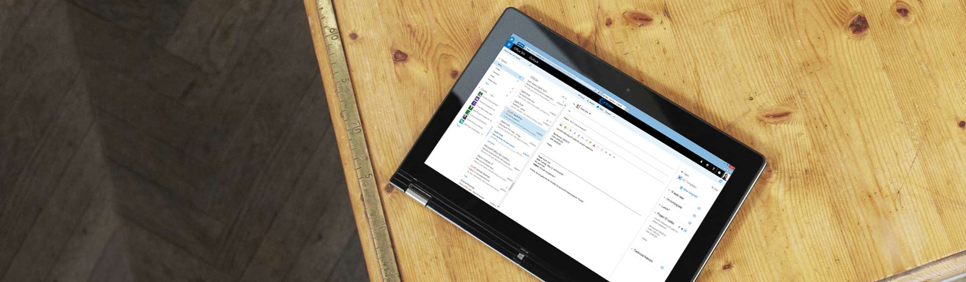 A tablet on a table showing a close-up of a business email inbox, powered by Exchange.