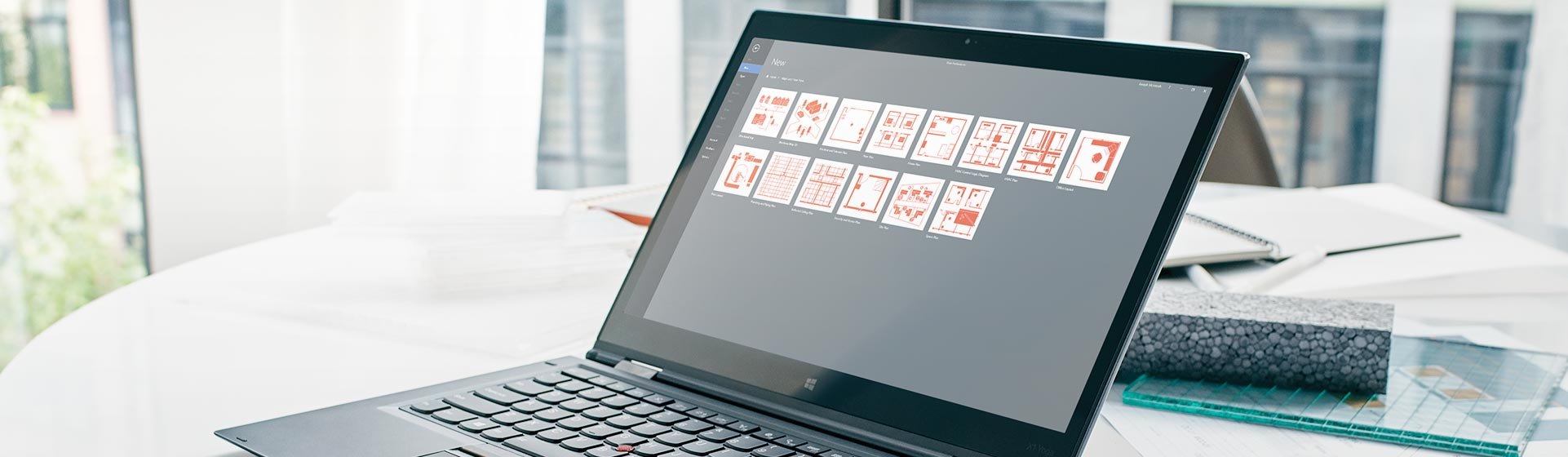 A Microsoft Surface tablet displaying floor plan templates in Visio