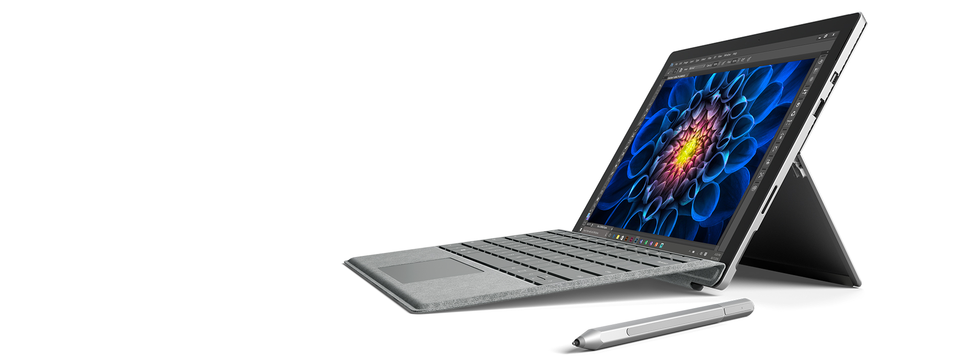 Surface Pro 4 in laptop mode facing left with a Surface Pen next to it
