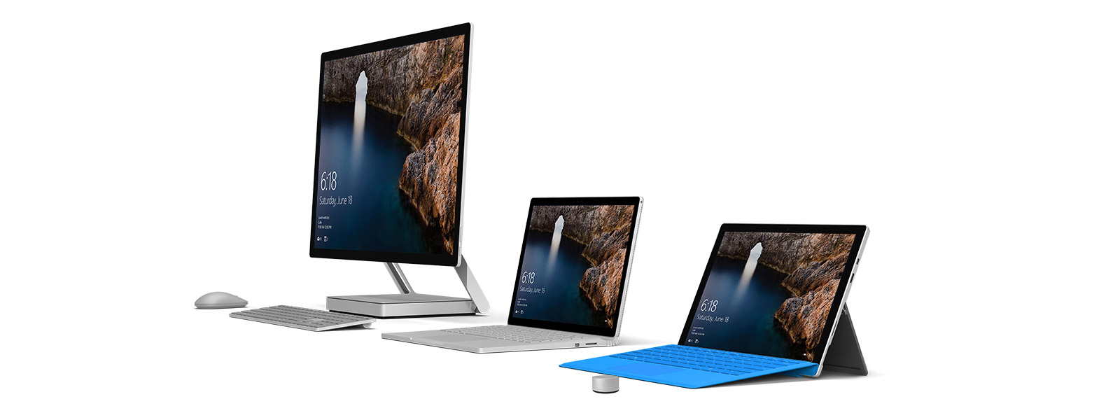 Surface Studio, Surface Book and Surface Pro 4 side by side with Surface Keyboard, Surface Mouse and Surface Dial