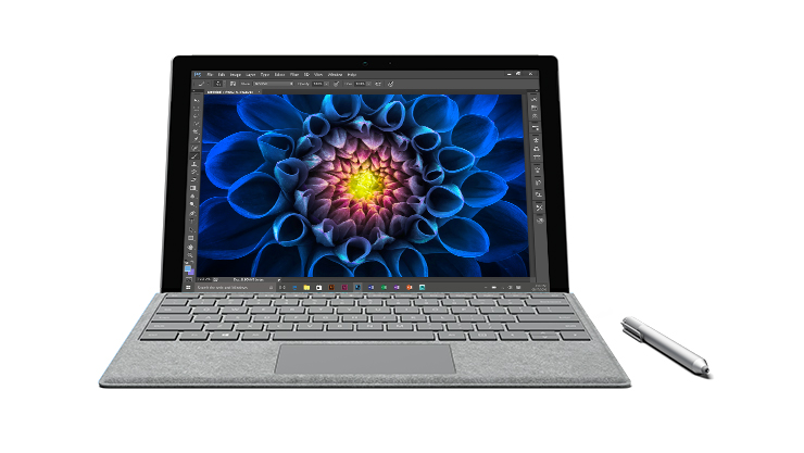 Surface Pro 4 facing front with Surface Pen next to it and a colorful image of an elephant open in Photoshop