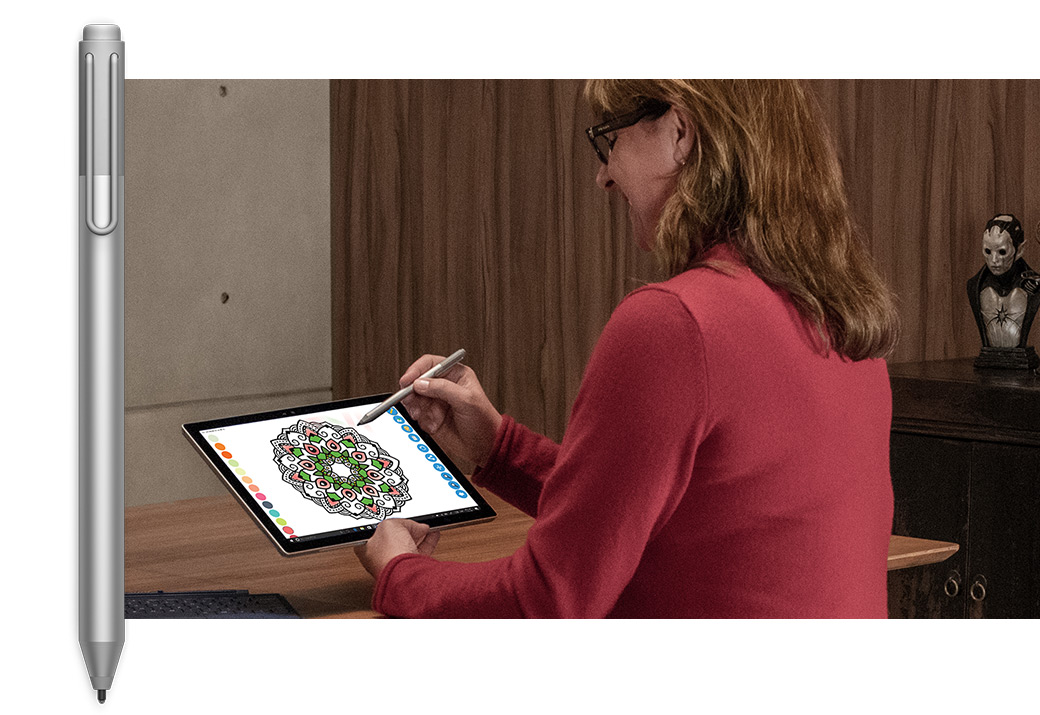 Image of Surface Pen upright, with an image of a woman drawing on an Surface Pro 4 in tablet mode next to it