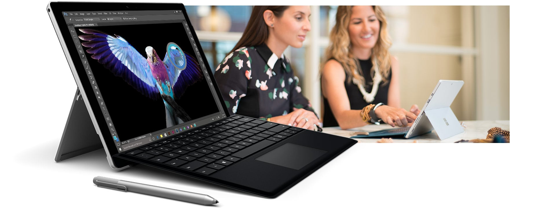 Surface Pro 4 with black keyboard open with Surface Pen next to it with an image of two women looking at a Surface Pro 4 in tablet mode behind it