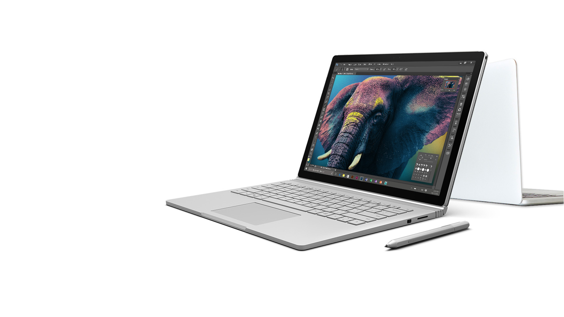 Surface Book and MAcBook Pro facing back to back with Surface Pen in the foreground