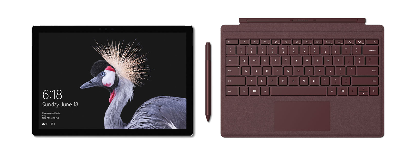 Image of Surface Pro with Surface Pro Signature Type Cover and Surface Pen in burgundy. Surface Pen accompanies.