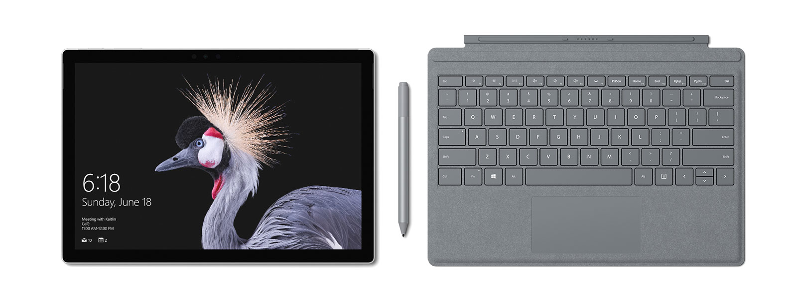 Image of Surface Pro with Surface Pro Signature Type Cover and Surface Pen in platinum. Surface Pen accompanies.