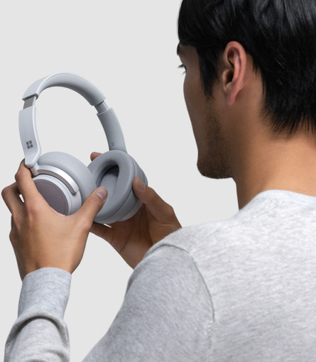 A man puts on Surface Headphones on his head
