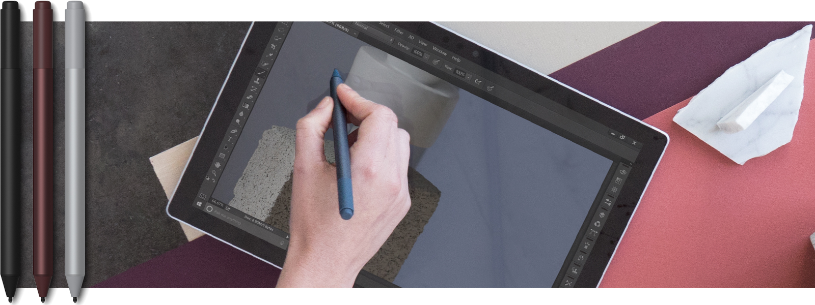 PERSON USING SURFACE AS TABLET WITH PEN AND TOUCH. THREE SURFACE PEN DEVICES IN DIFFERENT COLORS OVERLAY THE IMAGE.