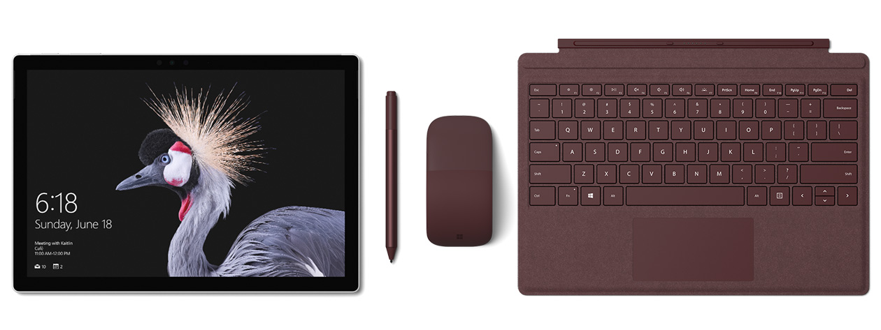 Image of Surface Pro with Surface Pro Signature Type Cover, Surface Pen and Surface Arc Mouse in burgundy. Surface Pen accompanies.