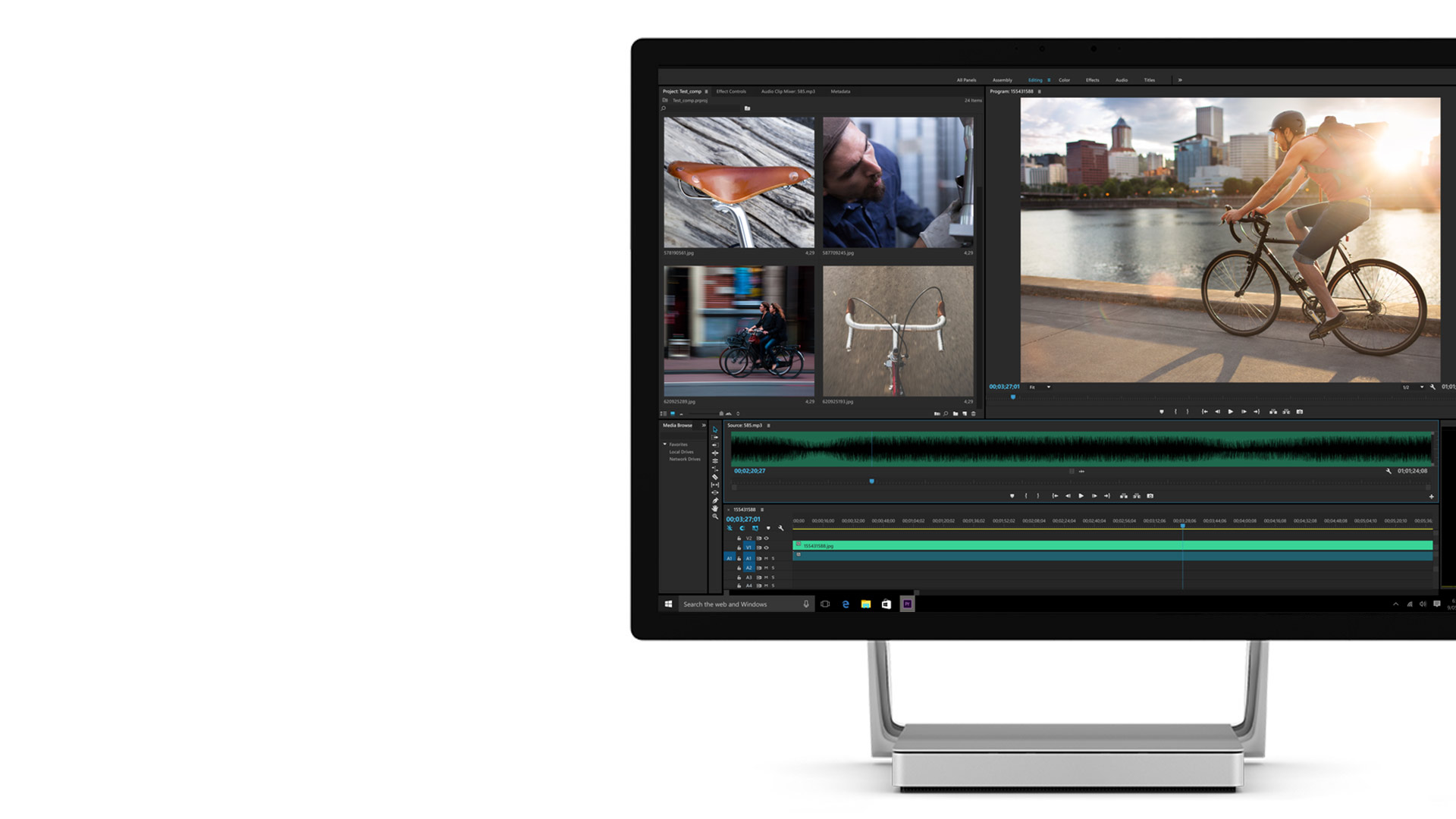 Adobe Premier open on the Surface Studio display