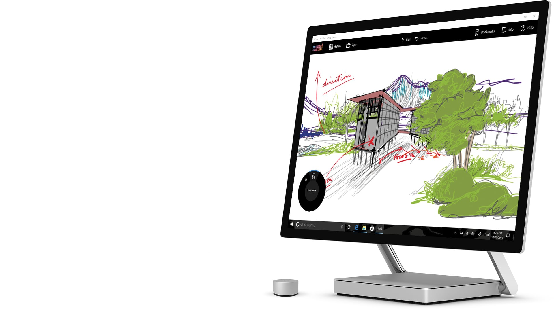 Surface Studio in desktop mode with Mental Canvas app open on screen and Surface dial on desk controlling an onscreen widget