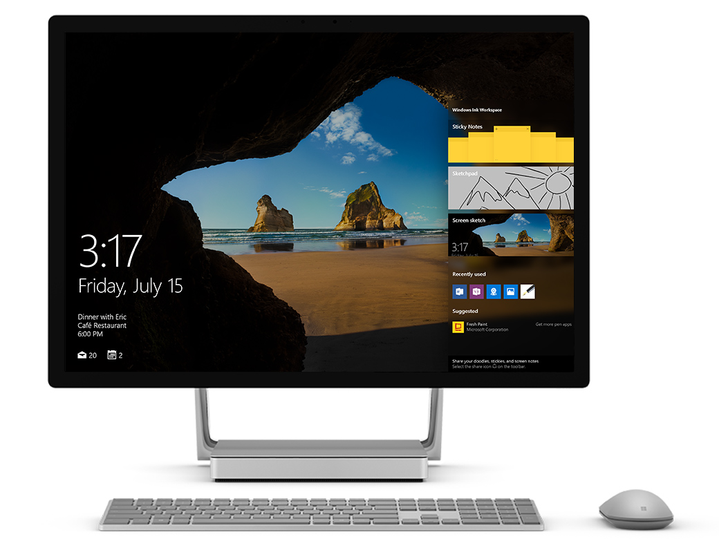 Surface Studio facing front with the Windows Action Center visible on the right of the screen