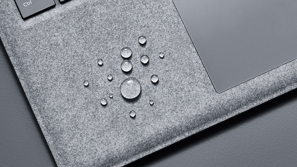 Surface Laptop Alcantara® keyboard with drops of water on the cover around the keyboard.