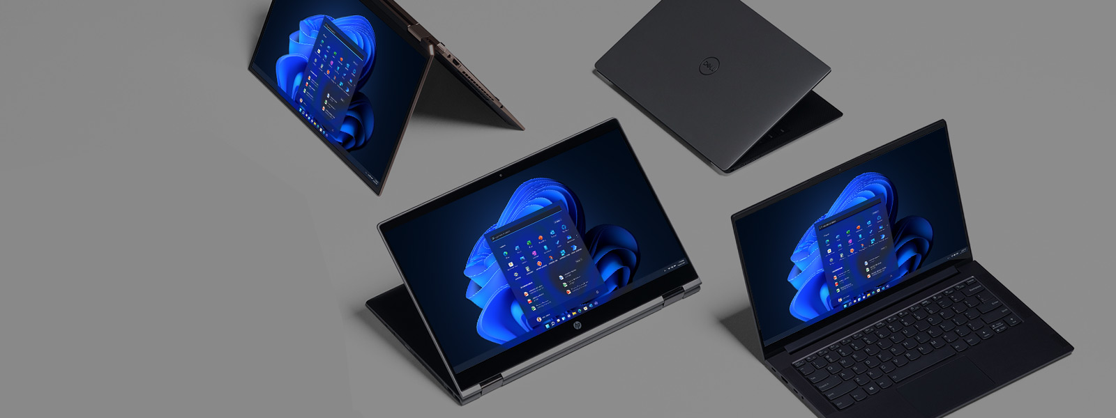 Four devices displaying the Windows 11 start screen