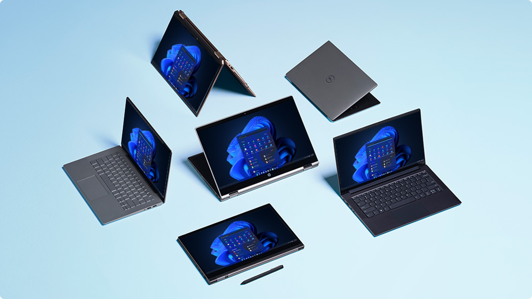 Multiple laptops and two-in-one devices displaying the Windows 11 start screen