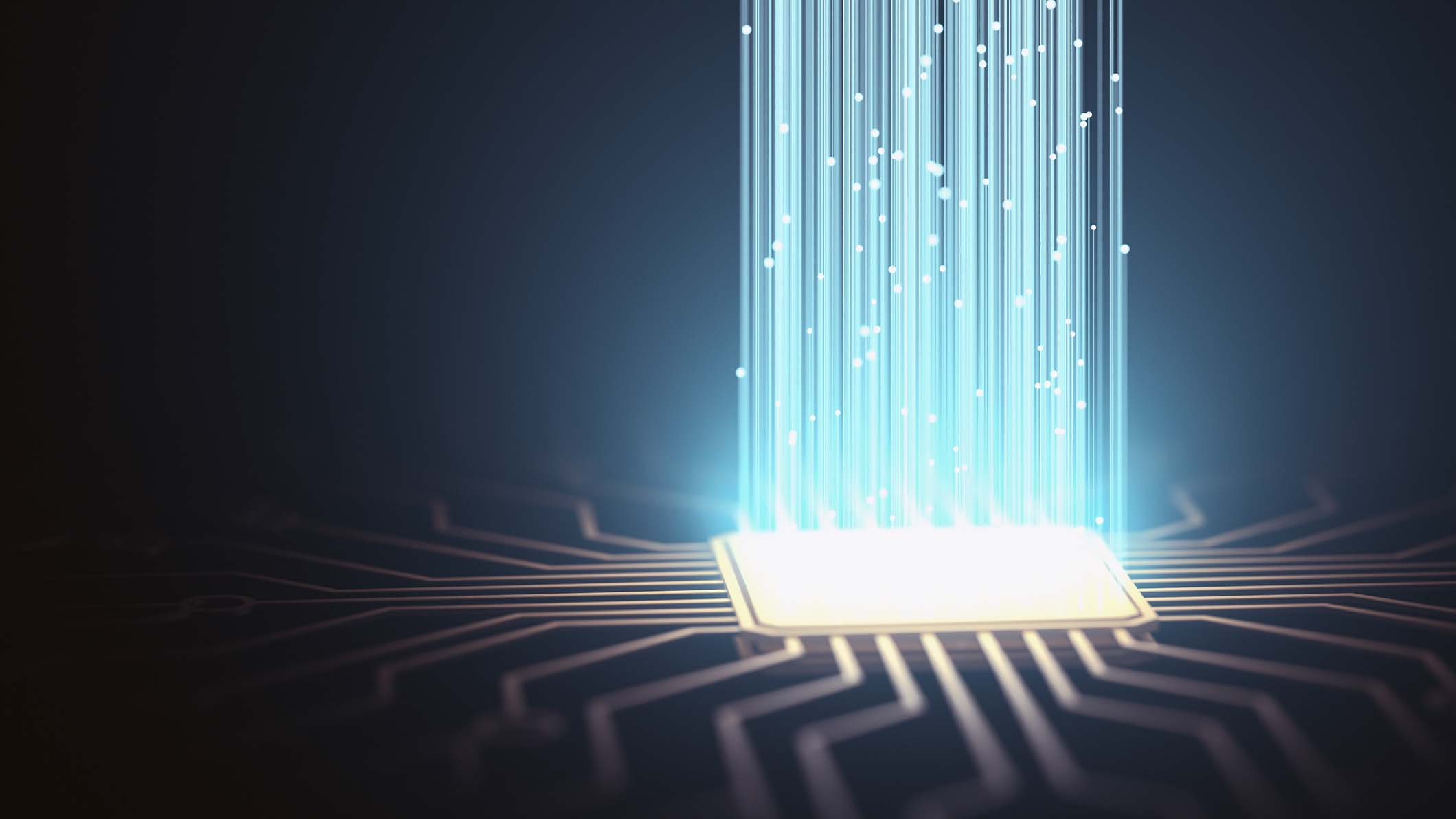 An illustration depicting a computer chip projecting beams of light upward