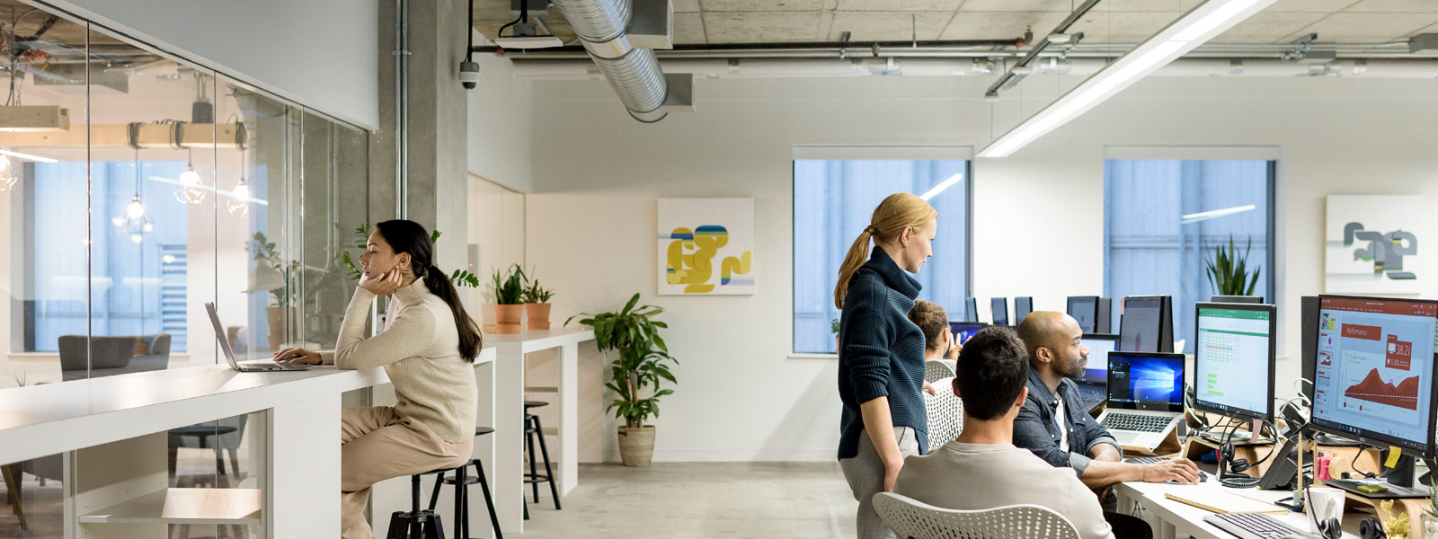 People collaborate in open office space