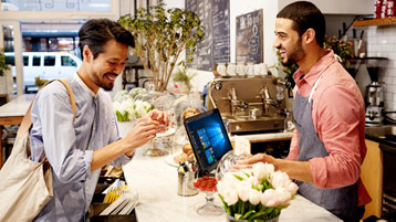 Men in retail store use digital kiosk