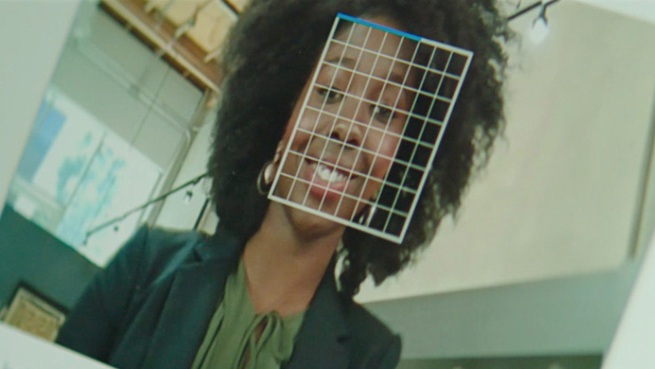 Facial recognition grid overlay of woman's face