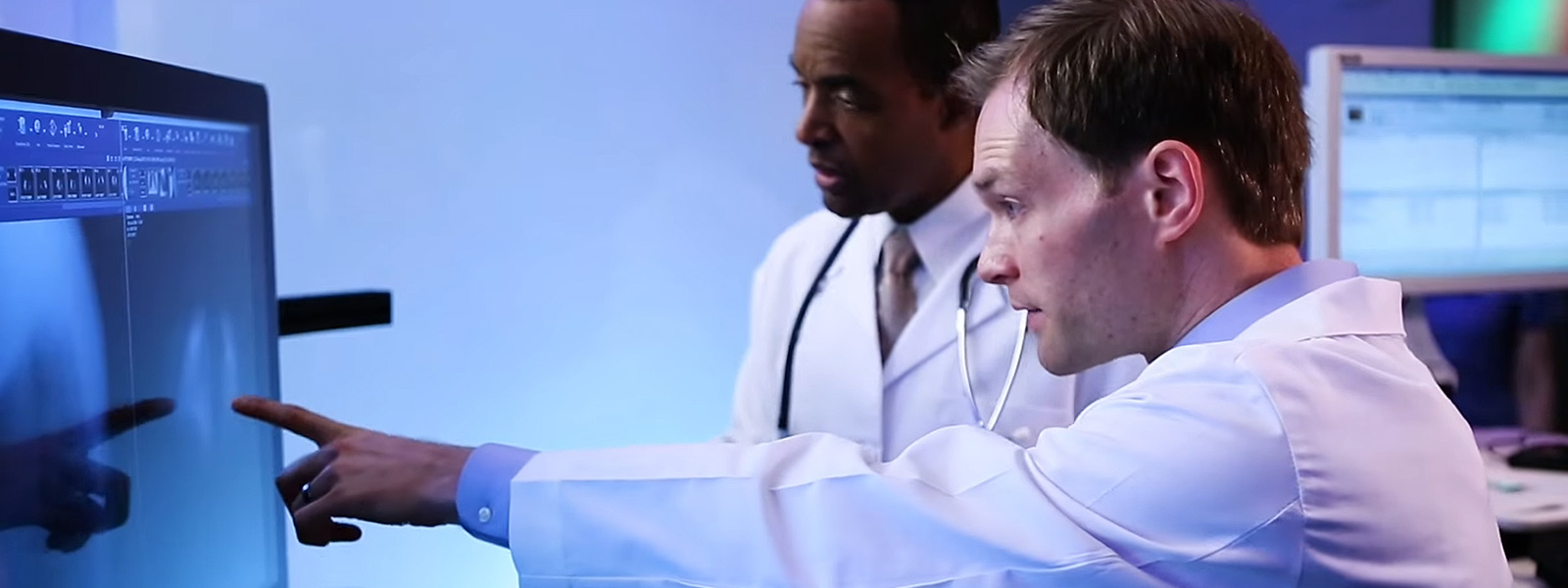 Two lab technicians working in lab