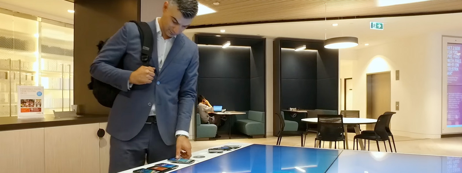 Businessman interacting with devices