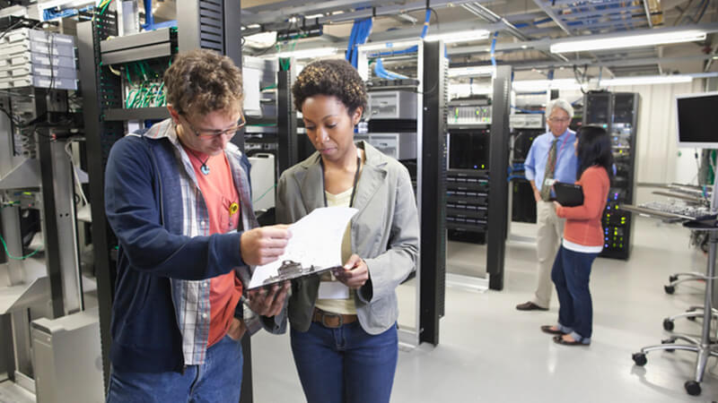 Data center with people working