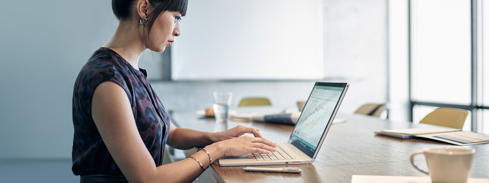 Woman typing on Surface Book