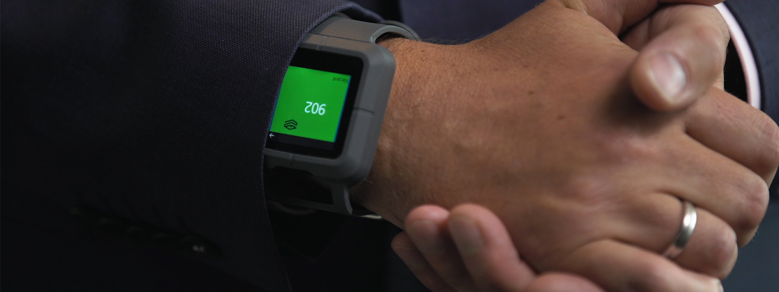 Hotel employee with wearable interactive device'