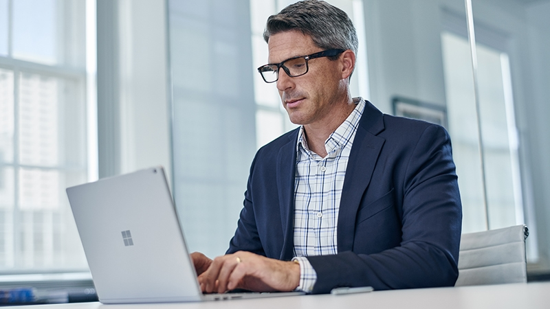 Business man working on a Windows laptop