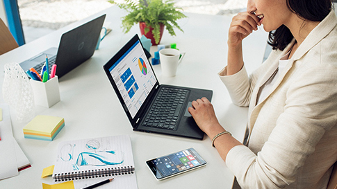 Woman using laptop to create a presentation