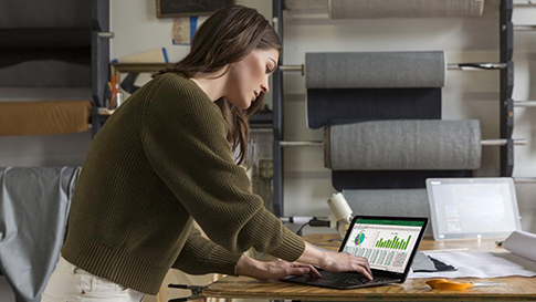 Woman using laptop to review data