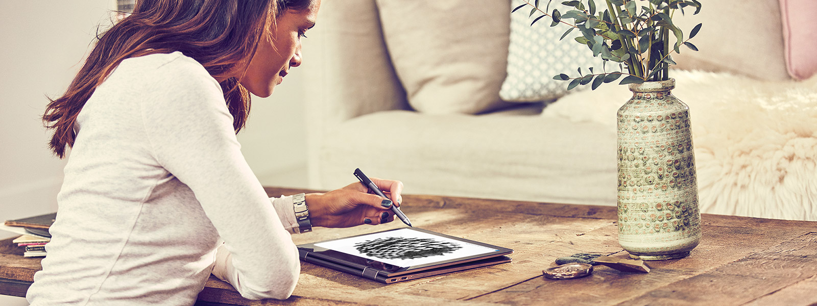 A woman using Windows Ink on an HP Spectre x360