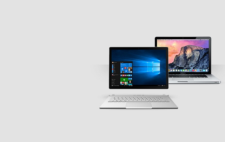 A Surface Book detaches next to a Macbook Pro