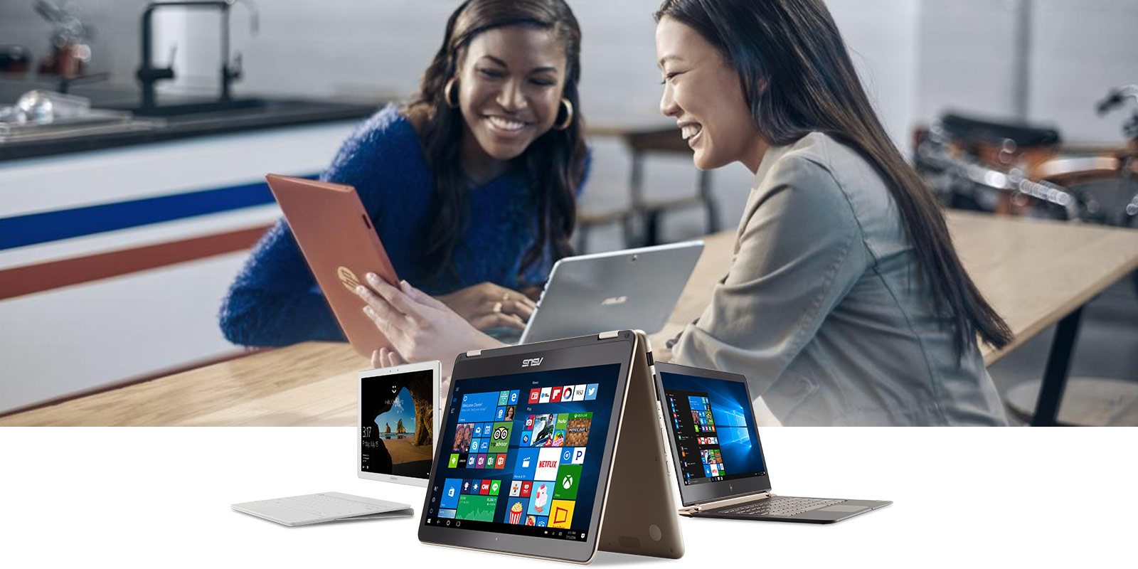 Several types of Windows 10 devices in dynamic formation with an image of two women sitting at a table looking at a tablet screen behind them